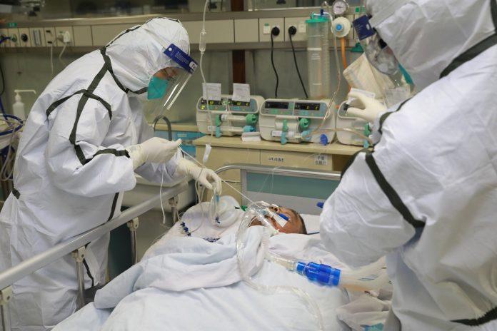 A coronavirus patient was treated this week at the Zhongnan Hospital of Wuhan University. Credit...China Daily, via Reuters